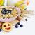 мюсли · фрукты · Ягоды · белый · продовольствие · стекла - Сток-фото © saharosa