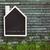 house shaped chalkboard on wooden background stock photo © sandralise