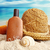 straw hat with towel and lotion on the beach stock photo © sandralise