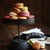 Cake stand with macaroons on dark wood background stock photo © Sandralise