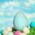 Páscoa · ovos · campo · grama · azul · céu - foto stock © sandralise