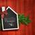 house shaped chalkboard on christmas background stock photo © sandralise
