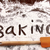 word baking written in white flour on wooden table stock photo © sandralise