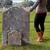 woman rests her hand thoughtfully on a headstone stock photo © sarahdoow