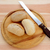 Three fresh rolls with a bread knife stock photo © sarahdoow