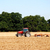 Tractor and harrow cultivating the soil stock photo © sarahdoow