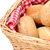 Closeup of fresh bread rolls in a wicker basket stock photo © sarahdoow