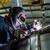 man welding with reflection of sparks on visor hard job stock photo © sarymsakov