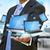 üzletember · tart · tech · berendezés · kéz · számítógép - stock fotó © sdecoret