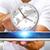businessman holding a clock over his digital tablet stock photo © sdecoret