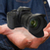 young man using modern camera stock photo © sdecoret