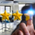businessman rating stars with his hand stock photo © sdecoret