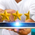 businessman rating stars with his tablet stock photo © sdecoret