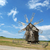 old windmill on a picturesque hill stock photo © serg64