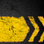 grunge distressed yellow direction road marking on dark metal ba stock photo © shawnhempel