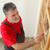 home renovation worker painting wooden door varnishing stock photo © simazoran