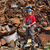 recycling industry worker stand at heap of old metal stock photo © simazoran