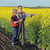 farmer and agronomist in blossoming rapeseed field stock photo © simazoran