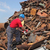 recycling industry worker at heap of old metal stock photo © simazoran