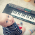 little baby boy plays on keyboard toy stock photo © simpson33