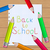 back to school message with pencils on paper sheet background stock photo © smeagorl