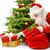 santa putting the gift boxes under the christmas tree stock photo © smileus