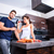 beautiful young couple cooking while drinking wine in the kitche stock photo © spectral