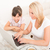 mother and daughter with a laptop at home stock photo © spectral