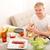 fiatal · éhes · férfi · eszik · szendvics · iroda - stock fotó © spectral