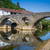 Rijeka Crnojevica old bridge panoraic view with reflections on the calm river waters. stock photo © Steffus