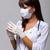 Arzt · halten · Impfstoff · Spritze · Ärzte - stock foto © stepstock