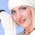 knitwear. woman wearing a winter cap and gloves closeup stock photo © stepstock