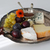 Cheese plate with fall fruits  stock photo © stickasa