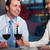 happy couple drinking red wine at a restaurant stock photo © stockyimages