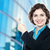 smiling corporate lady pointing away stock photo © stockyimages