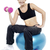 woman seated on fitness ball doing dumbbells stock photo © stockyimages