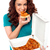 young cheerful girl enjoying pizza alone stock photo © stockyimages