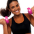 happy fitness woman lifting dumbbells stock photo © stockyimages