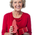 senior woman with heart shaped gift box stock photo © stockyimages