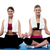 two young girls doing yoga at gym stock photo © stockyimages