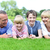 happy family lying on lush green grassland stock photo © stockyimages