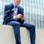 üzletember · küldés · szöveg · telefon · iroda · telefon - stock fotó © stockyimages