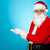 santa against blue background posing with open palms stock photo © stockyimages