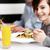 boy enjoying food and fresh juice stock photo © stockyimages