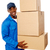 young delivery guy holding stack of parcel boxes stock photo © stockyimages