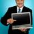 üzletember · mutat · ujj · laptop · képernyő · boldog - stock fotó © stockyimages