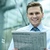 handsome businessman reading a newspaper stock photo © stockyimages