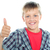 boy in trendy clothes showing thumbs up sign stock photo © stockyimages