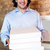 smiling man holding pizza boxes stock photo © stockyimages