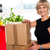 blonde woman is ready to unpack her office stuff stock photo © stockyimages